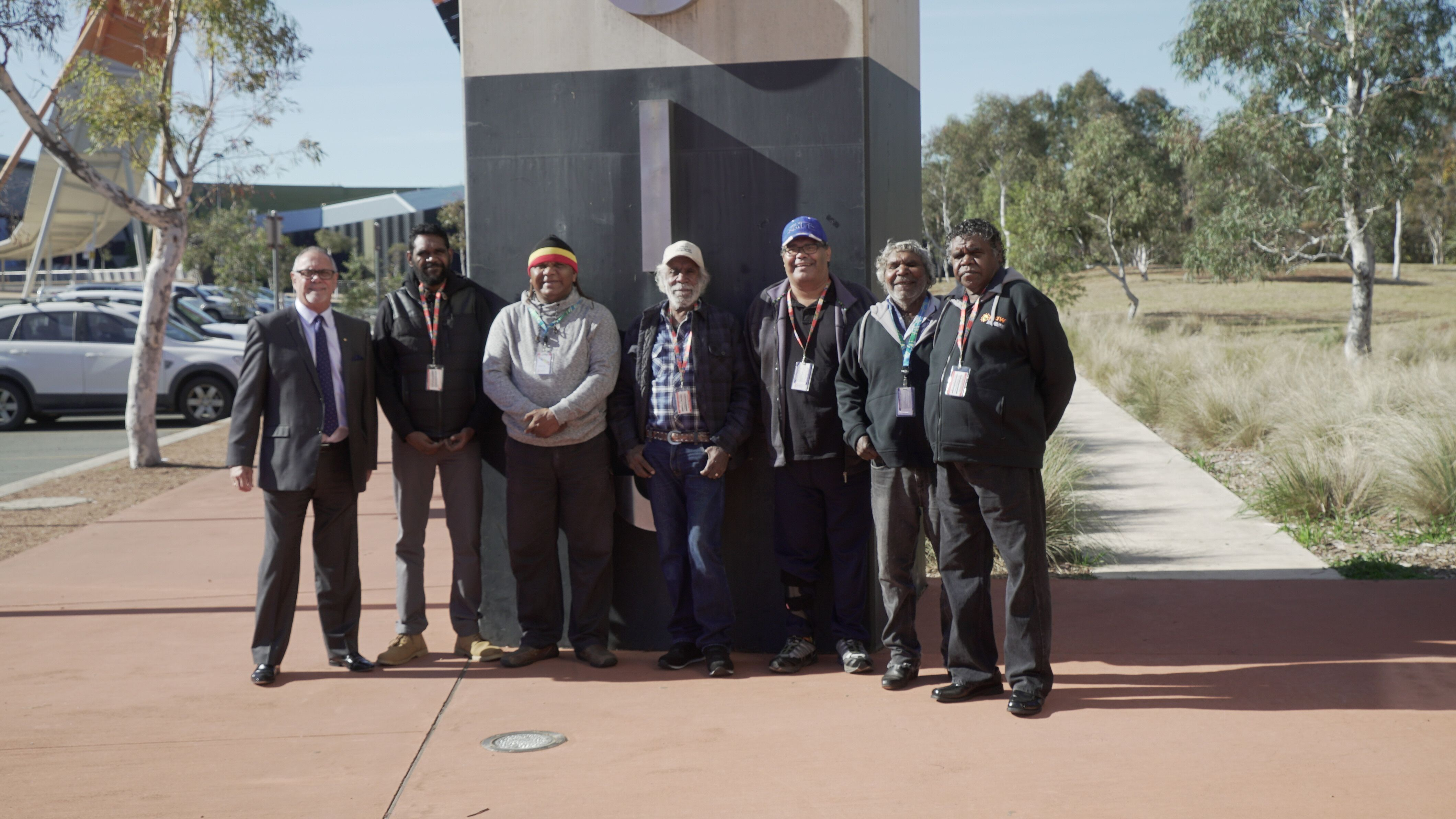 Arrernte and Warlpiri representatives with WCE staff collaborate on the repatriation of Olive Pink's Collection.  From left to right: Russell Taylor, AM, Chief Executive Office of AIATSIS, Simon Fisher Junior, Baydon Williams, Peter Wallace, Mick Campbell, Harry Jones and Simon Fisher Senior.